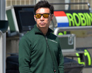 Kamui Kobayashi looks on in the pit lane