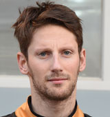 Romain Grosjean waits to get back into the Lotus