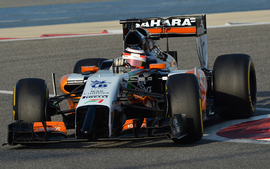 Nico Hulkenberg turns into a corner with the Force India