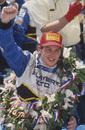 Jacques Villeneuve celebrates in Victory Lane