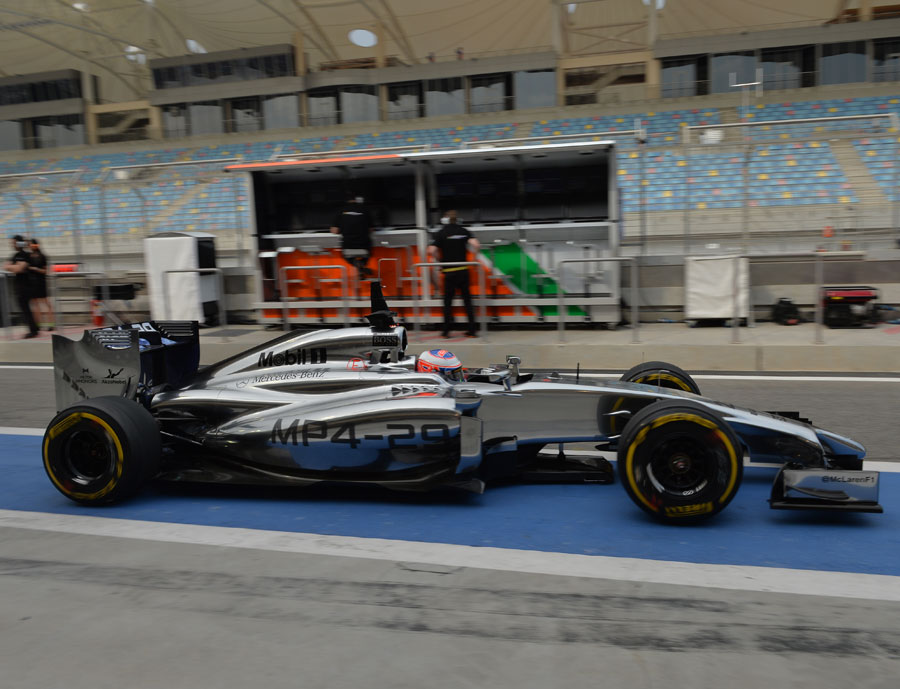 Jenson Button leaves the pits on Friday morning