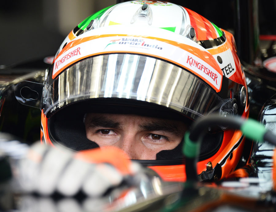 Sergio Perez waiting in the cockpit in between testing runs