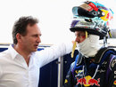 Christian Horner talks to Sebastian Vettel after he exits the RB10
