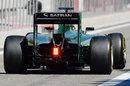 Kamui Kobayashi drive along the pit lane