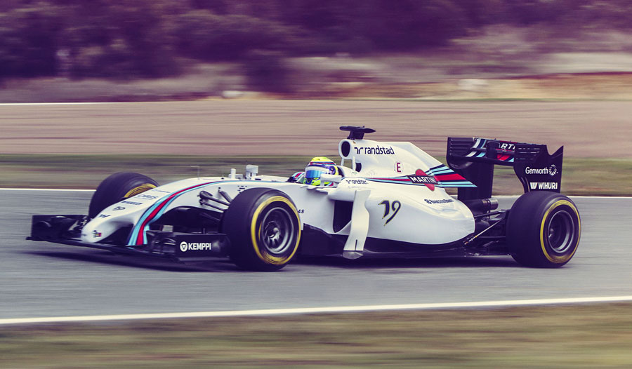 A side on view of the Felipe Massa behind the wheel of the Williams FW36, with its new Martini livery