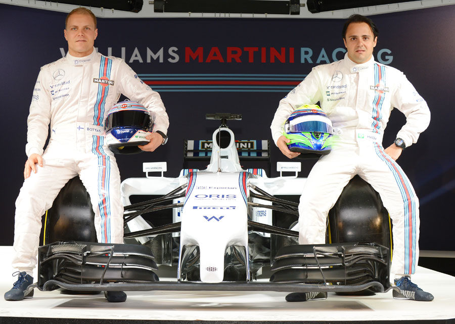 Valtteri Bottas and Felipe Massa pose with the Williams FW36