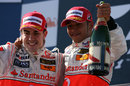 Fernando Alonso and Lewis Hamilton celebrate second and third on the podium