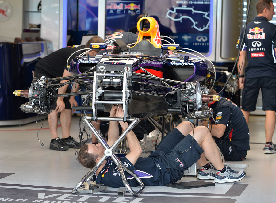 mechanics work on the red bull rb10 in full view of photographers formula 1 photos. Black Bedroom Furniture Sets. Home Design Ideas
