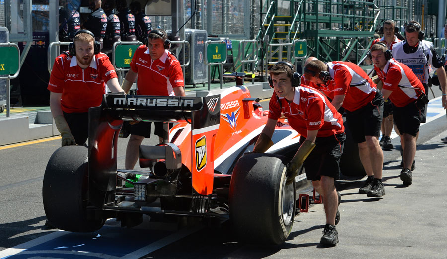 Max Chilton is wheeled back to the garage after failing to make it down the pit lane in FP1