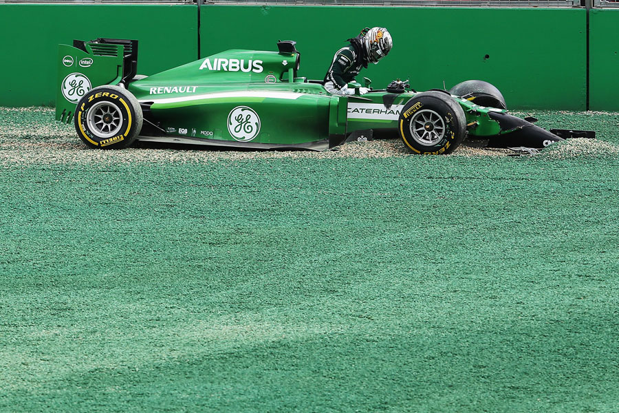 Kamui Kobayashi climbs out of his Caterham after crashing out at Turn 1