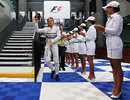 Nico Rosberg makes his way to the podium