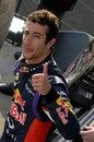 Thumbs up from Daniel Ricciardo as he leaves the podium
