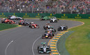Nico Rosberg leads into Turn Two as Kamui Kobayashi and Felipe Massa make contact
