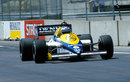 Keke Rosberg powers down the main straight on his way to victory