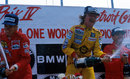 Keke Rosberg celebrates victory alongside Ferrari duo Stefan Johansson and Michele Alboreto