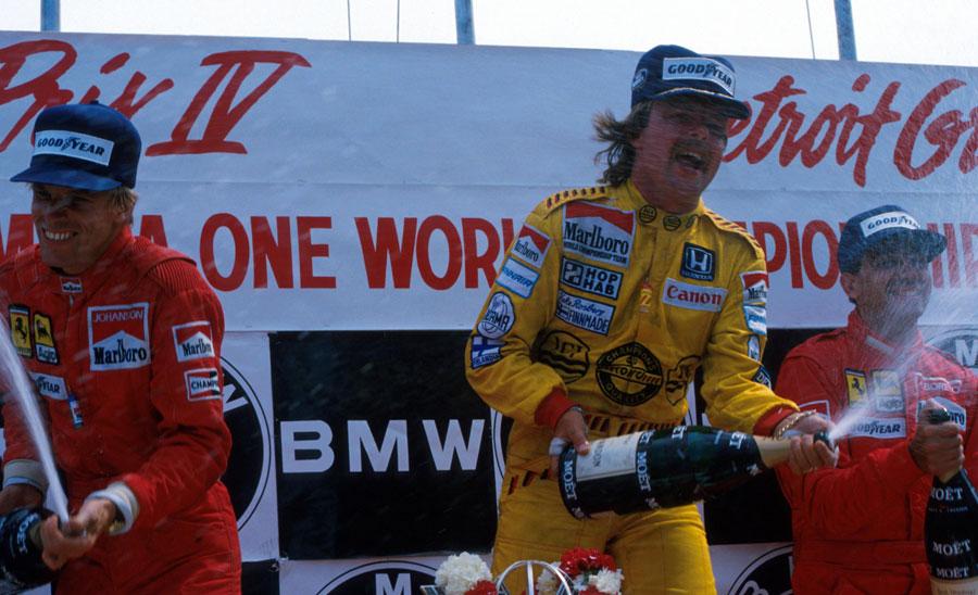 Keke Rosberg celebrates victory alongside Ferrari duo Stefan Johansson and Michele Alboreto