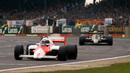 Ayrton Senna chases down McLaren's Alain Prost