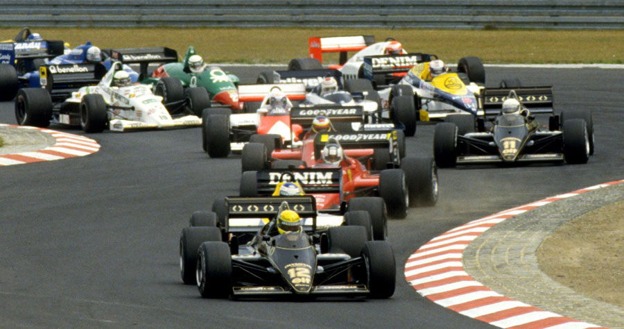 Ayrton Senna leads the pack out of the opening chicane