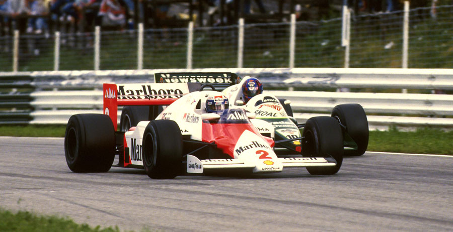 Alain Prost powers past a backmarker