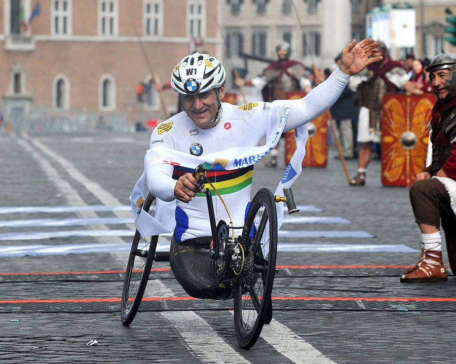 Alex Zanardi crosses the line to win the Handbike Race at the Marathon of Rome