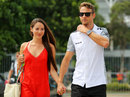 Jenson Button and his fiancée  Jessica Michibata arrive at the circuit