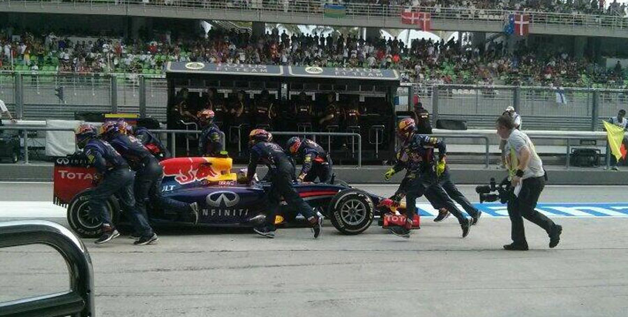 What a mess ... Daniel Ricciardo is pushed back to his pit after being released too early