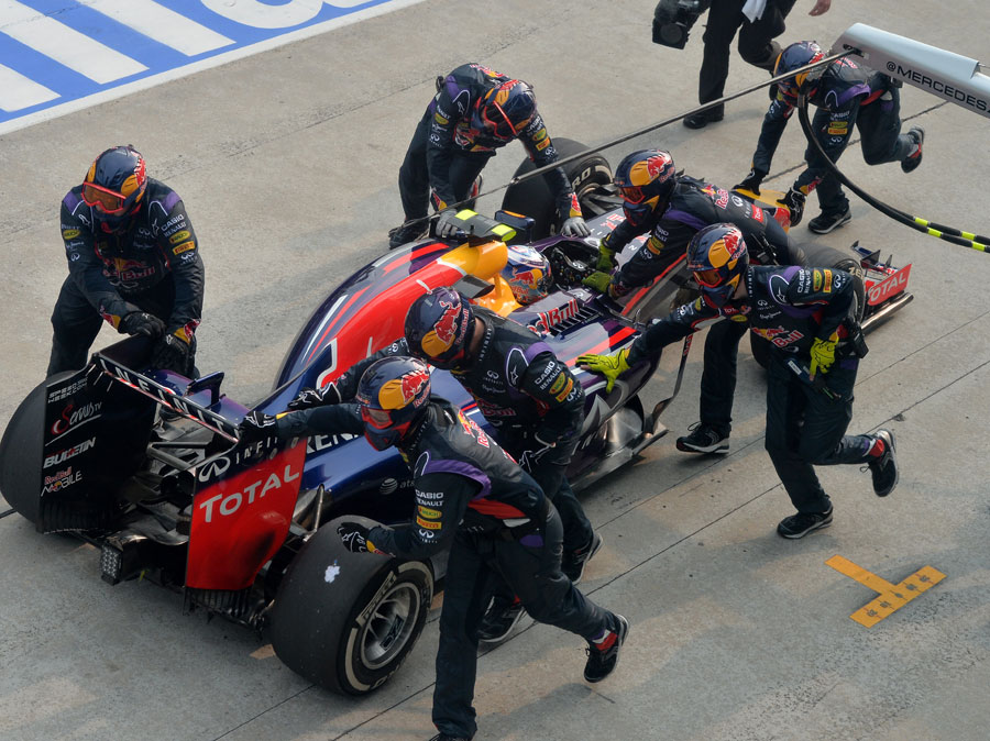 Daniel Ricciardo's pit crew scramble him back to their slot after his botched pit stop
