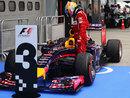 Fernando Alonso inspects Sebastian Vettel's Red Bull in parc ferme