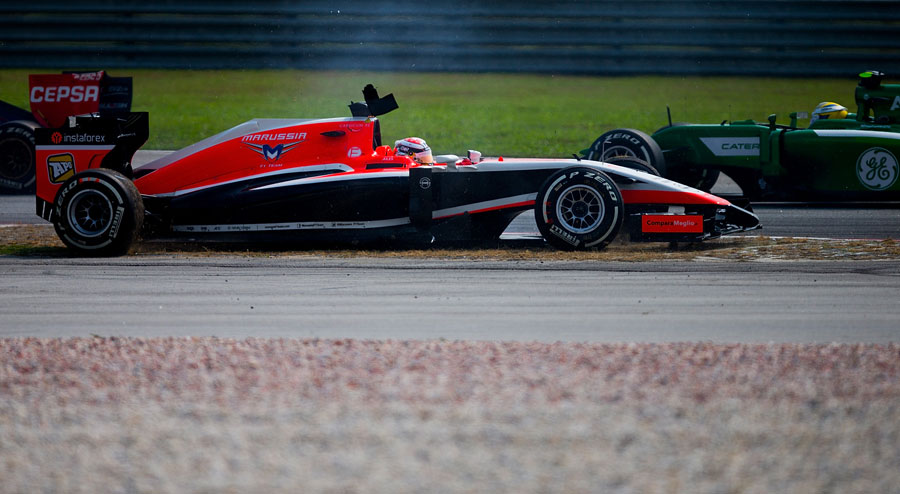 Jules Bianchi ends up backwards in the gravel after making contact with Pastor Maldonado