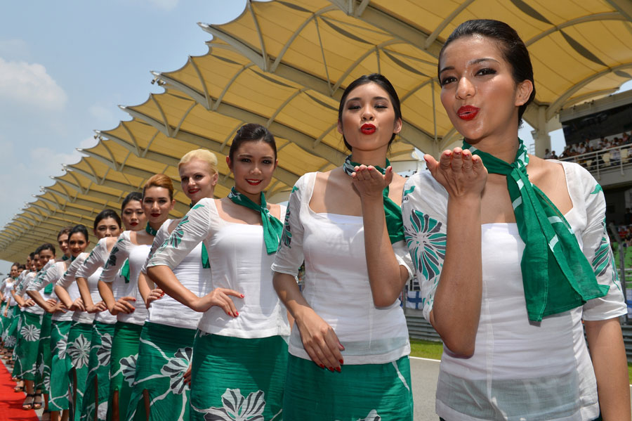 Grid girls pose for a photo before the race