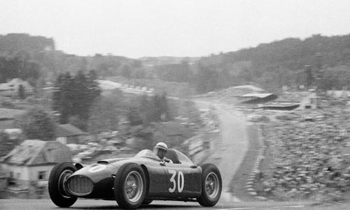 Italian racing driver Eugenio Castellotti comes over the top of Radillon after Eau Rouge