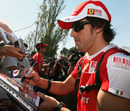 Fernando Alonso signs programmes for F1 fans