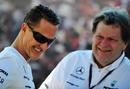 Michael Schumacher shares a joke with Norbert Haug in the Albert Park Paddock