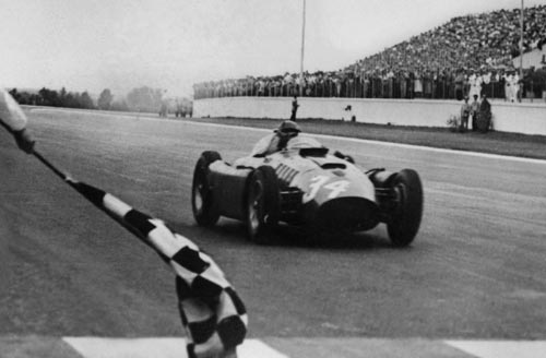 Juan Manuel Fangio crosses the line to win the Argentinean Grand Prix
