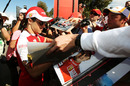 Felipe Massa signs autographs for the fans