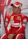 Felipe Massa waits in the Ferrari garage