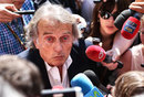Ferrari president Luca di Montezemolo gets swarmed by media in the paddock on Sunday