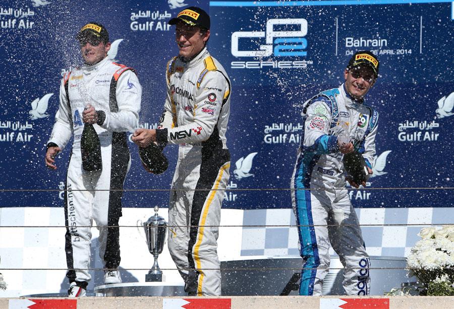 Jolyon Palmer celebrates victory on the podium