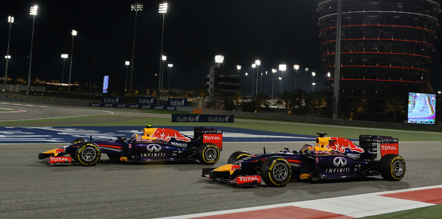 Daniel Ricciardo passes Sebastian Vettel into Turn 1