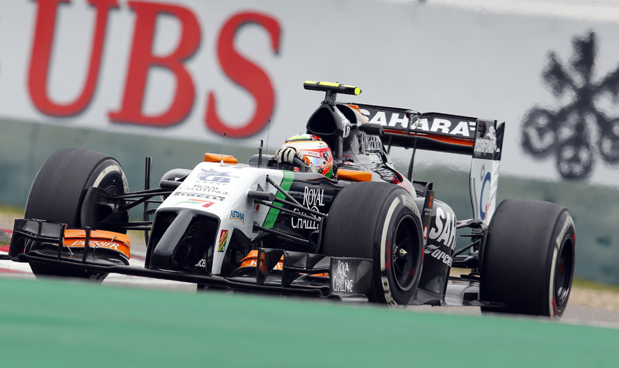 Sergio Perez navigates through a corner during Friday practice