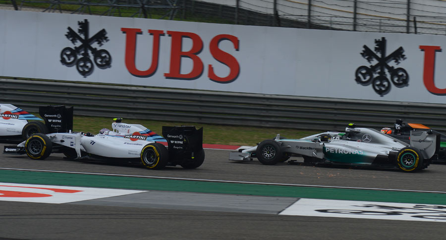 Valtteri Bottas recovers after making contact with Nico Rosberg