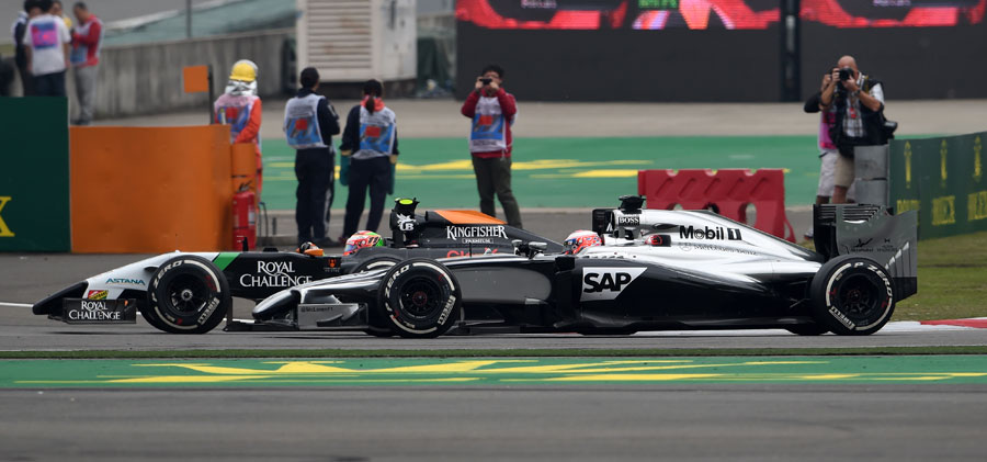 Sergio Perez passes former team-mate Jenson Button into Turn 1