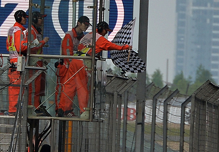 The chequered flag waves at the end of the race