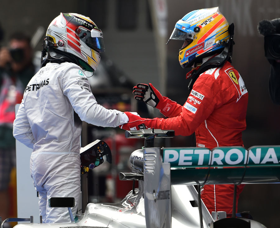 Fernando Alonso congratulates Lewis Hamilton on his victory in parc ferme