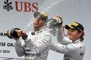 Lewis Hamilton and Nico Rosberg celebrate on the podium