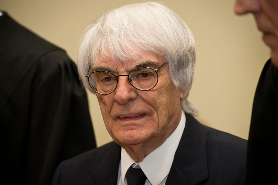 Bernie Ecclestone stands in court at the beginning of the first day of his bribery trial