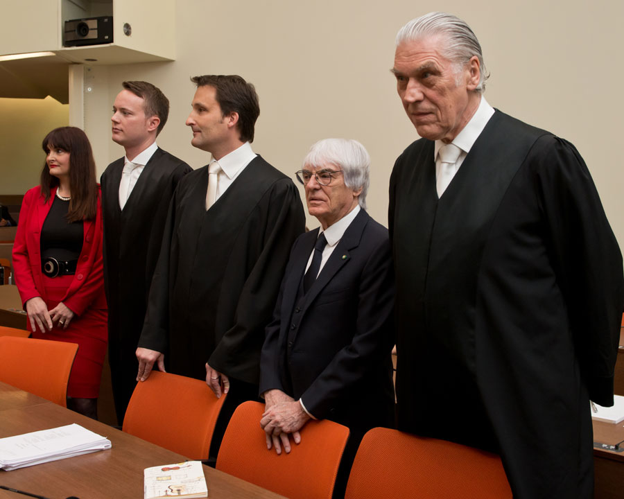 Bernie Ecclestone in court, flanked by lawyers  Andreas Weitzell (left) and Norbert Scharf