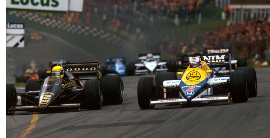 Ayrton Senna and Nigel Mansell vie for position going into Paddock Hill Bend