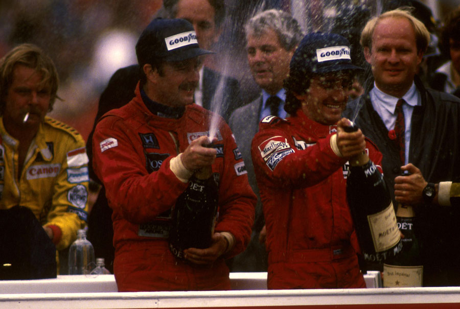 Nigel Mansell celebrate his maiden victory alongside team-mate Alain Prost, whose four points were enough to secure the title