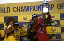 Nigel Mansell hoists the winners' trophy after his second successive victory